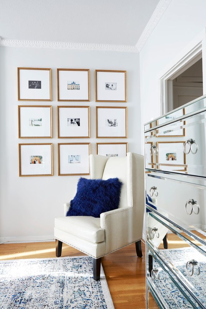 Gold Leaf Picture Frames with Transitional Bedroom and Blue Pillows Fur Pillows Gallery Wall Gold Framed Art Gray Walls Grommet Chair Ivory Armchair Light Wood Floors Mirror Dresser Wall Art