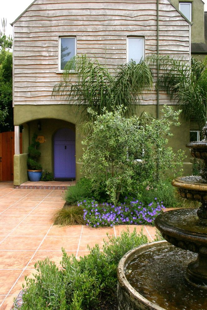 Golden Gate Villa Santa Cruz with Mediterranean Exterior Also Acid Stained Concrete Concrete Concrete Paving Container Plants Courtyard Entrance Entry Fountain Front Door Green Walls Patio Planters Potted Plants Topiary Water Feature Wood Siding