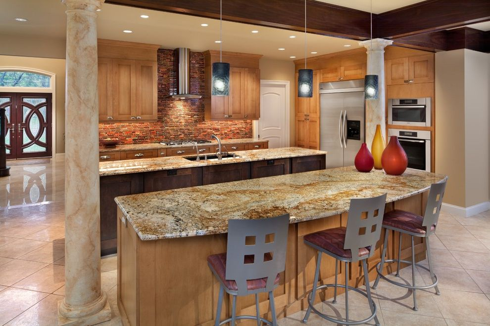 Golden Nugget Rooms   Contemporary Kitchen  and Counter Stools Dark Stained Wood Beams Double Doors Marbled Columns Natural Wood Cabinets Pendant Lights Stainless Steel Appliances Tile Floor Transom Wall Oven
