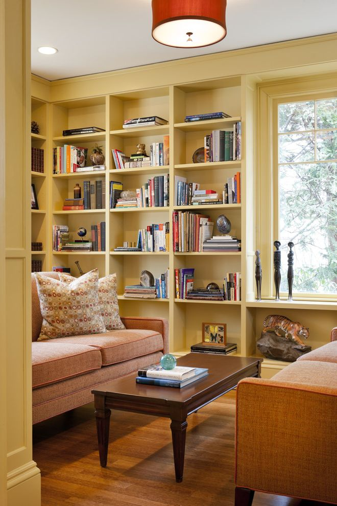 Golden Nugget Rooms with Eclectic Living Room  and Bookcase Books Bookshelves Built in Bookshelves Ceiling Light Coffee Table Color Gold Library Mustard Orange Orange Sofa Sofa Warm Yellow Bookshelves