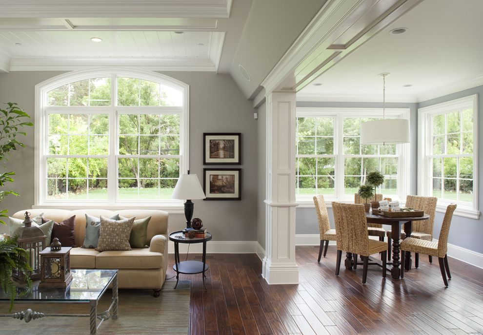 Golden Nugget Rooms with Traditional Family Room Also Arched Window Baseboards Beige Sofa Crown Molding Family Room Framed Door Opening Gray Walls Great Room Nook Round Dining Table White Trim Wood Ceiling Wood Floors Woven Dining Chairs