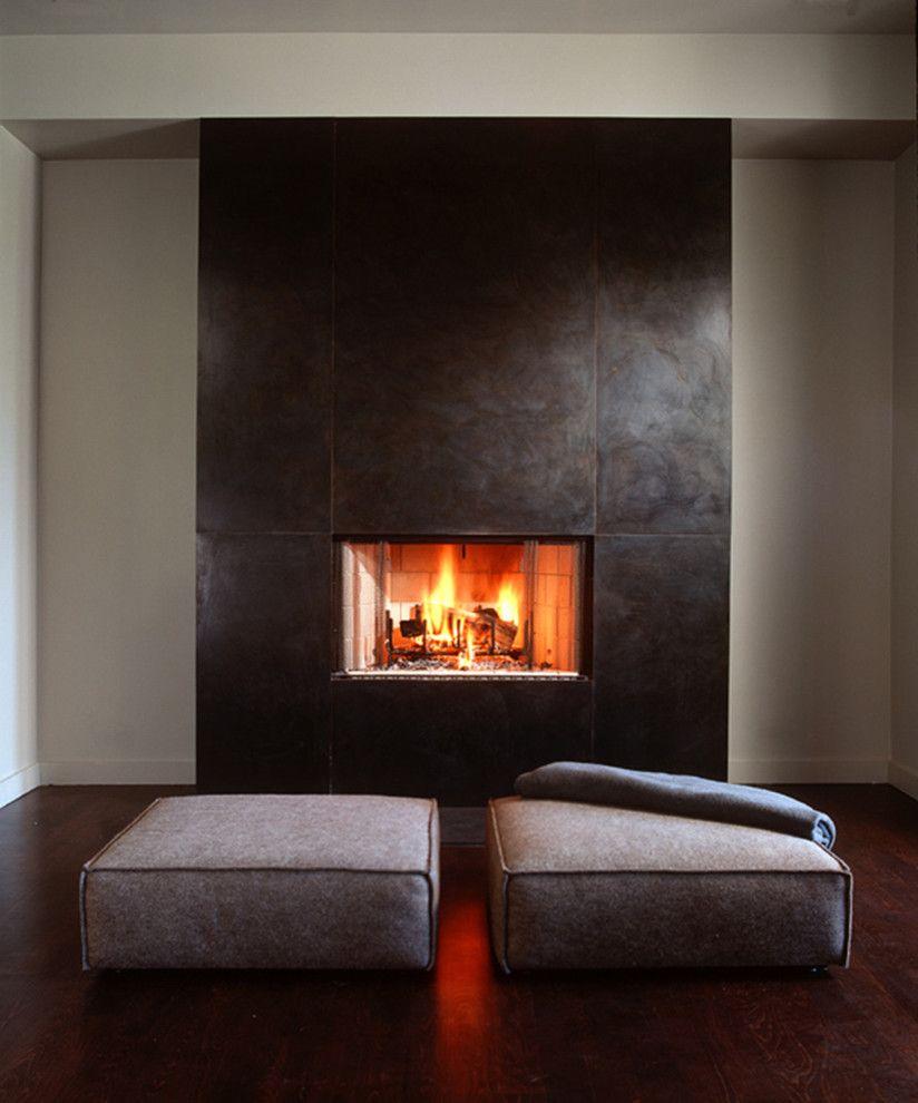 Goose Creek Heating and Air   Modern Living Room Also Bathroom Bedroom Dark Hardwood Floors Fireplace Floor Pillows Hearth Metal Minimal Modern Stair Steel Steel Fireplace Surround
