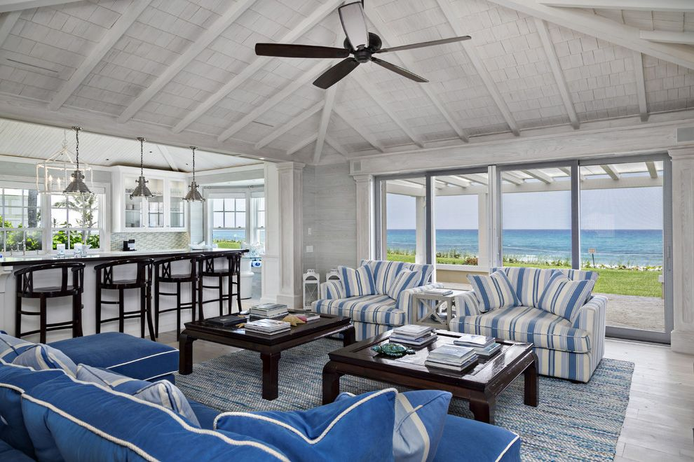 Grand Floridian Beach   Beach Style Living Room  and Area Rug Blue Couch Ceiling Fan Coastal Decorative Pillows Great Room Rafters Sloped Ceiling Striped Armchair Throw Pillows Vaulted Ceiling Whitewashed Wood Ceiling Wood Coffee Table