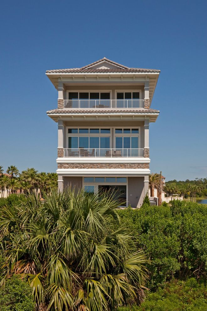 Grand Floridian Beach with Tropical Exterior  and Clay Tile Roof Covered Deck Deck Palm Trees Tropical Plants White Railing