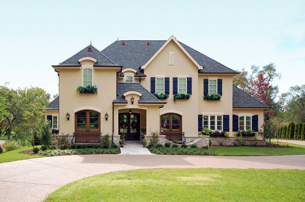 Grand Manor Roof with Traditional Exterior  and Arched Doors Arched Entry Copper Gutters Country French Planter Boxes Schaub Srote Stone Stone Planter Stucco