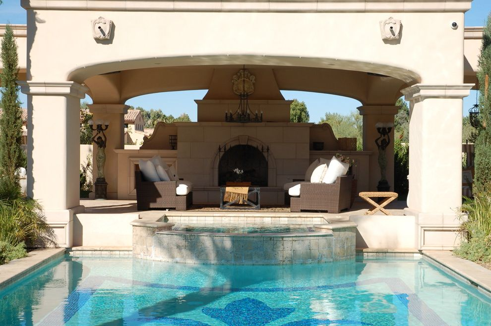 Grande Med Spa   Mediterranean Pool  and Arches Covered Porch Fireplace Outdoor Entertaining Outdoor Furniture Patio Pool Seating Area Stone Fireplace Surround Woven Lounge Chairs