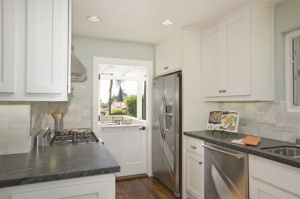 Granite Countertops San Jose   Beach Style Kitchen Also Benjamin Moore Built in Hutch Laundry Laundry in Kitchen Palladian Blue Seafoam Walls Shaker Doors Shallow Drawers Square Sticking Shaker Stacked Laundry White Kitchen