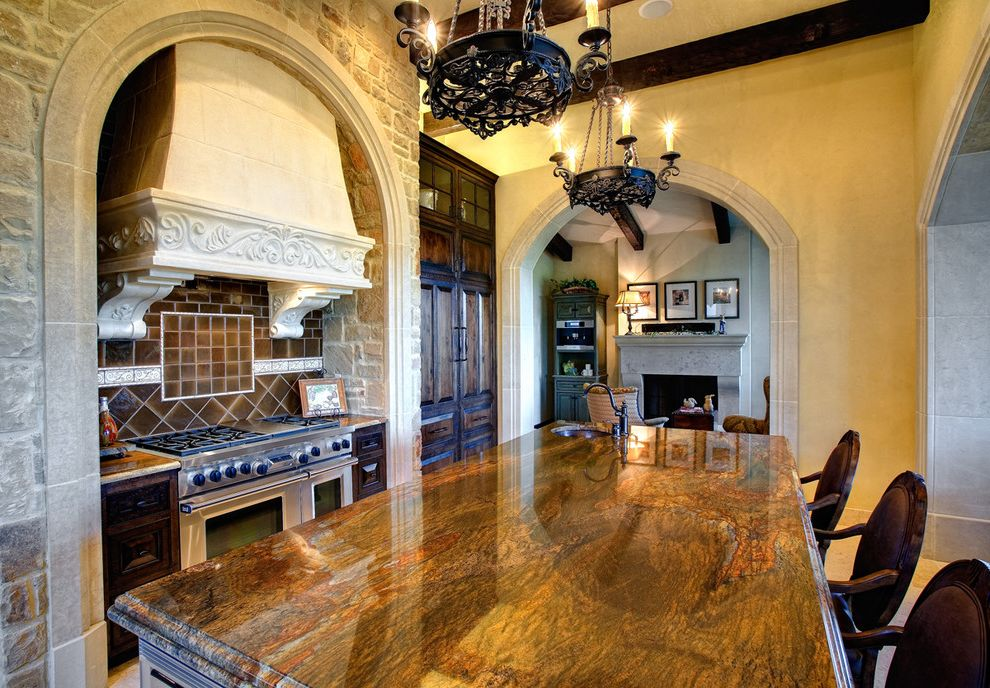 Granite Transformations Cost   Mediterranean Kitchen  and Arches Chandelier Counter Stools Eat in Kitchen Exposed Wood Beams Glazed Tile Backsplash Island Ornate Stone Walls White Range Hood Wood Cabinets