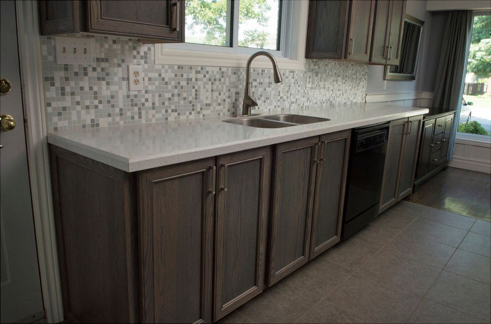 Granitetransformations Com   Traditional Kitchen Also Engineered Stone Glass Mosaic Granite Transformations Gray Grey Grey Backsplash Mosaic Tile Oak Reface Stain Stainless Tile Undermount Sink Wood Cabinets Wood Door