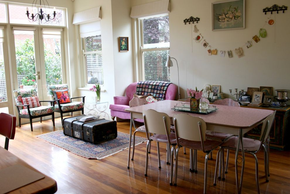 Granny Pods Floor Plans with Shabby Chic Style Spaces  and Antique Trunk Bold Colors Chandelier Double Hung Windows French Doors Glass Doors Great Room Open Floor Plan Photo Garland Pink Sofa Wall Art Wall Decor Wood Flooring