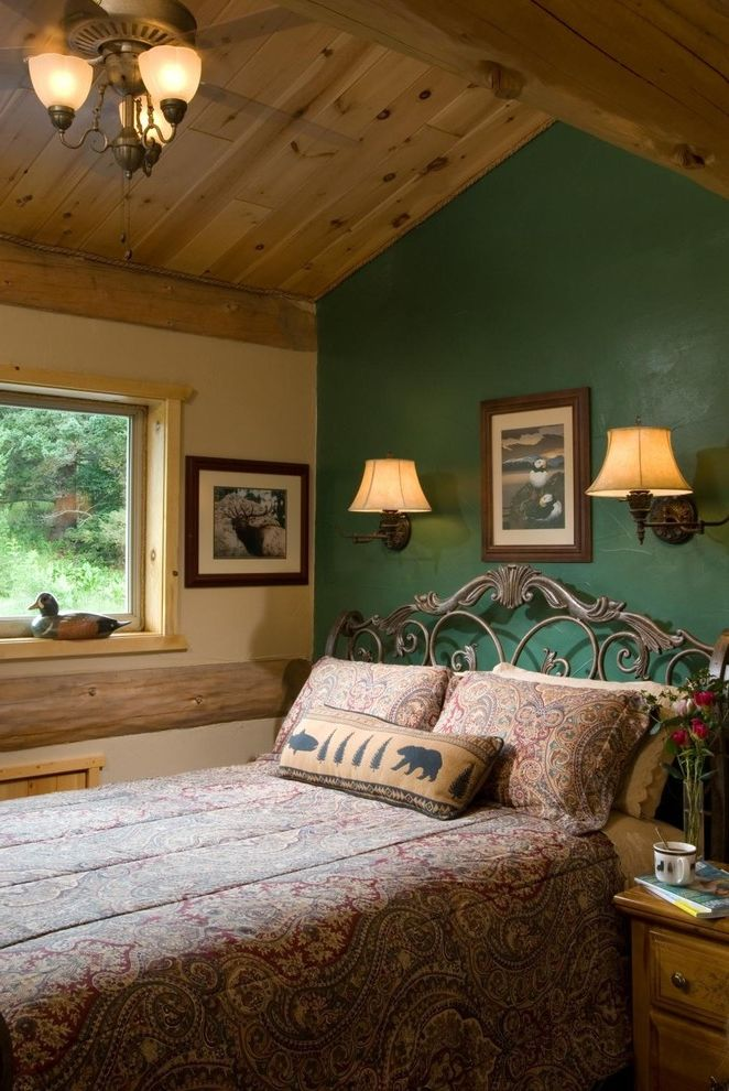 Green Board Drywall   Rustic Bedroom Also Beams Bedding Cabin Ceiling Fan Chandelier Framed Art Green Accent Wall Log Cabin Nightstand Ornate Bed Frame Pillows Sloped Ceiling Timber Wall Mounted Lamp Window Window Sill Wood Paneling