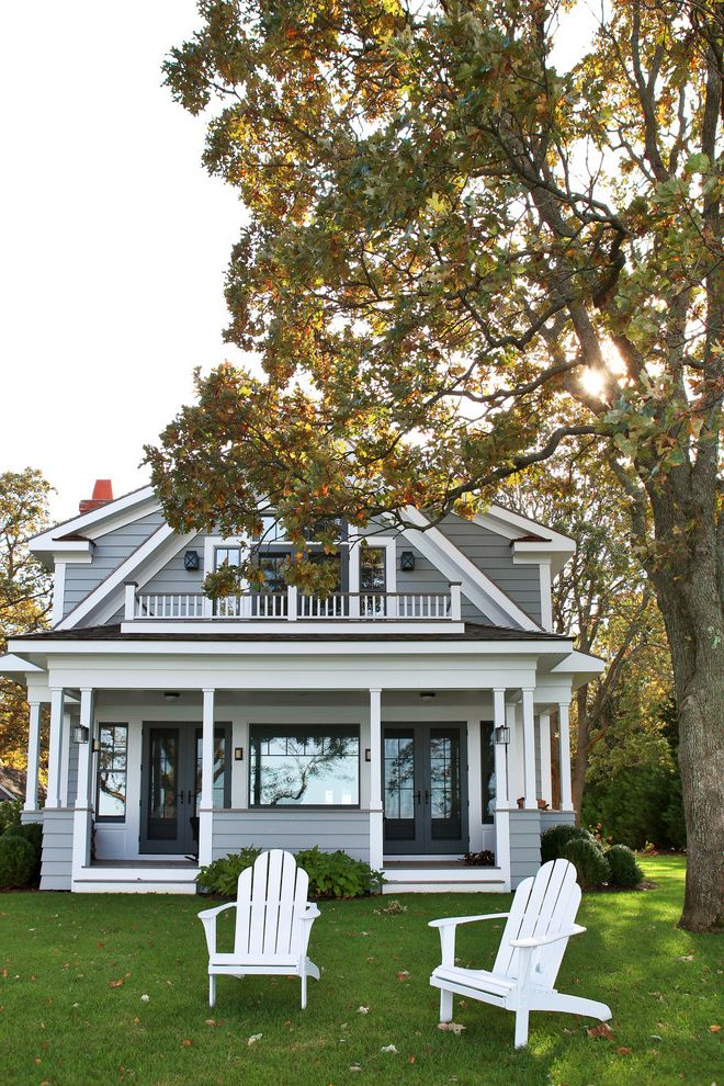 Grey House White Shutters   Beach Style Exterior Also Double Entry Glass Doors Grass Gray Exterior Gray Siding Lawn Porch White Adirondack Chair White Beam White Post White Railing