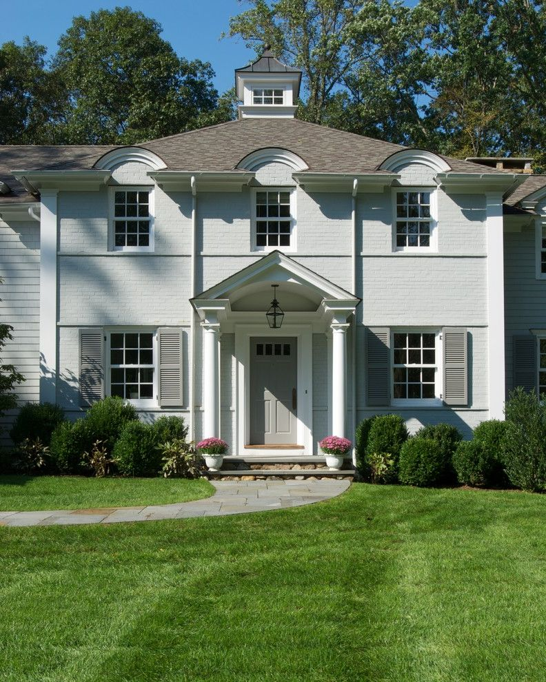 Grey House White Shutters   Traditional Exterior Also Arch Detail Front Exterior Gray Brick Gray Exterior Gray Shutters Grey Brick Grey Exterior Grey Shutters Potted Plant Stone Pathway Stone Stairs Stone Walkway White Columns White Trim