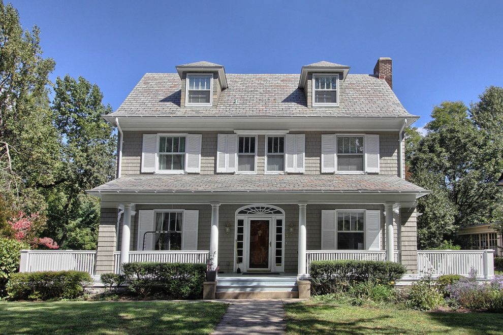 Grey House White Shutters   Traditional Exterior Also Colonial Columns Curb Appeal Dormers Foundation Planting Front Door Front Porch Grass Lawn Shingle Siding Shrubs Turf White Trim Window Shutters Wood Railing