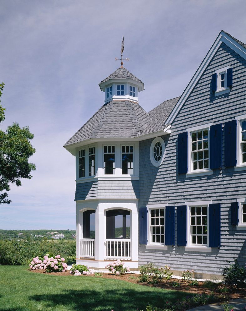 Grey House White Shutters   Traditional Exterior  and Bark Mulch Blue Siding Cupola Double Hung Windows Flowers Gable Roof Garden Grass Lawn Open Landscaping Porch Porthole Window Shutters Side Yard Weather Vane White Window Casing Wood Railing