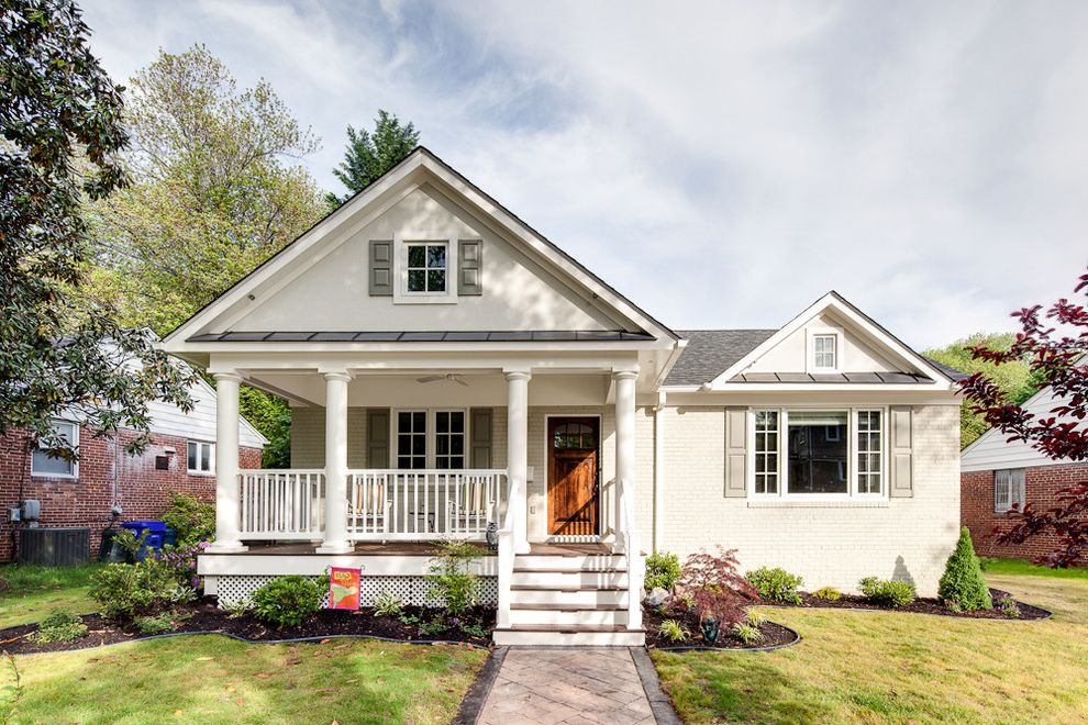 Grey House White Shutters   Traditional Exterior  and Bark Mulch Covered Entry Covered Porch Front Door Garden Grass Hardscape Landscape Lawn Metal Awning Path Pavers Plants Railing Shingle Roof Shutters Steps Walkway White Brick White House Wood Door