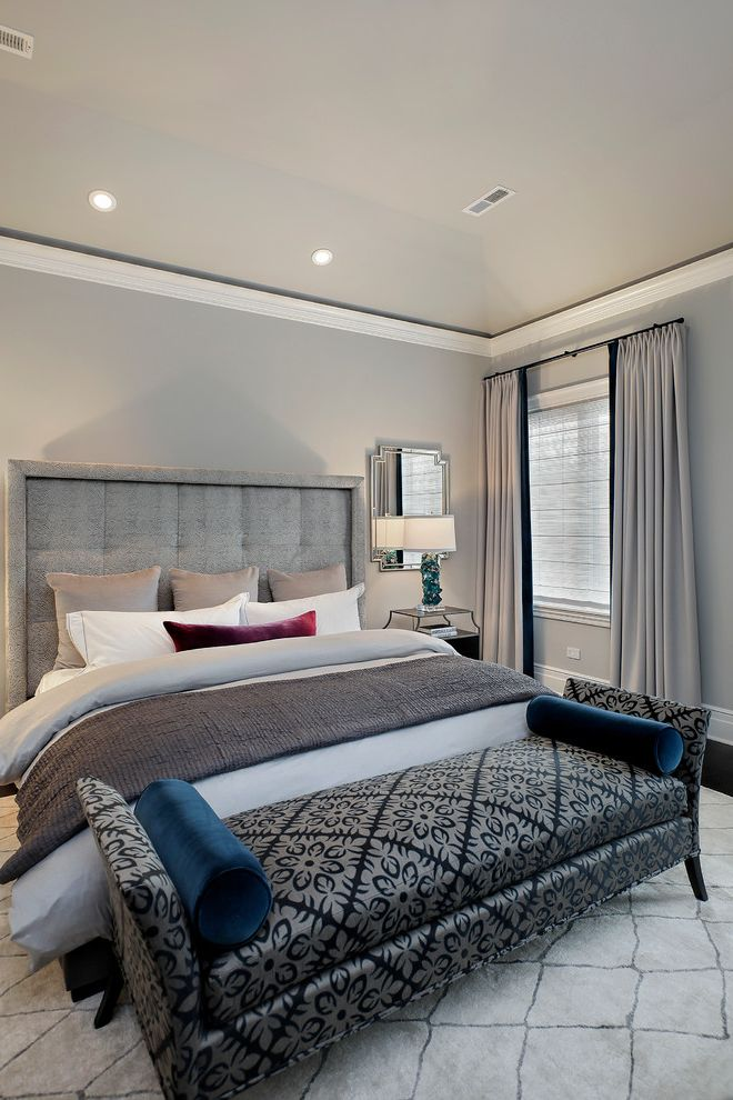 Grey Striped Sheets with Transitional Bedroom  and End of Bed Bench Gray Bedroom Gray Curtains Gray Headboard Gray Pillows Gray Throw Blanket Gray Walls Lattice Rug Recessed Lighting Tufted Gray Headboard Velvet Pillows White Sheets