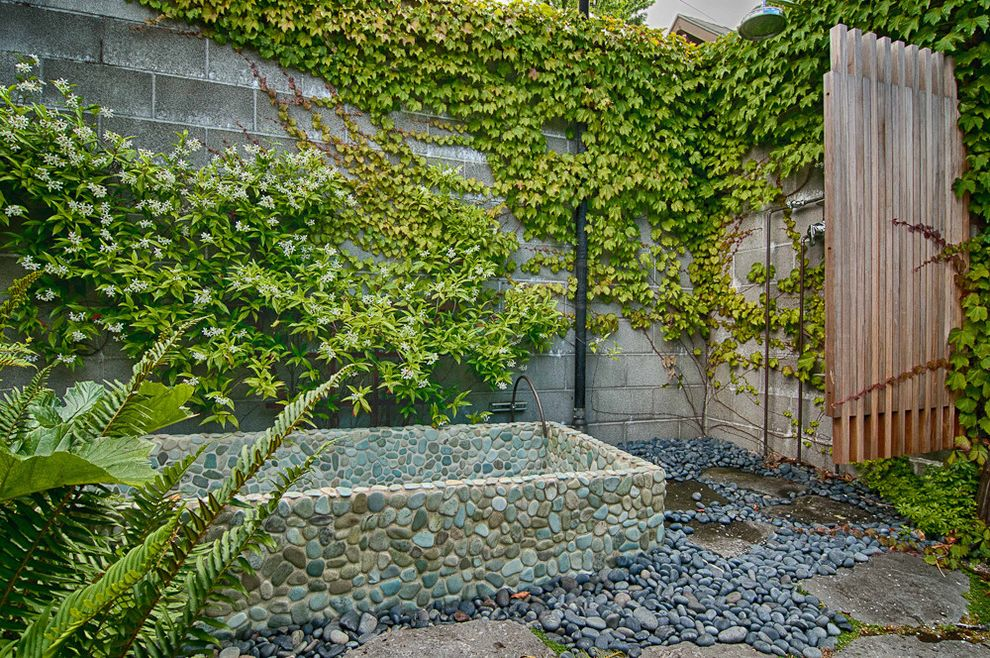 Grotto Boston   Eclectic Landscape  and Garden Wall Hot Tub Ivy Outdoor Shower River Rock Soaking Tub Stepping Stones Stone Tub Stone Wall