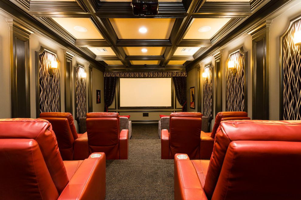Grundy Center Theater with Traditional Home Theater  and Ceiling Lighting Coffered Ceiling Home Screening Room Home Theater Projector Recessed Lighting Red Armchairs Sconce Stadium Seating Wall Lighting