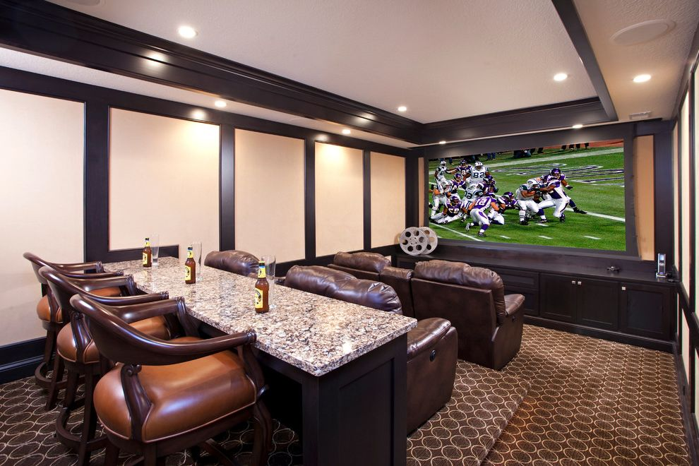 Grundy Center Theater with Traditional Home Theater  and Ceiling Lighting Dark Trim Home Theater Leather Recliners Recessed Lighting Screening Room Stadium Seating Tray Ceiling