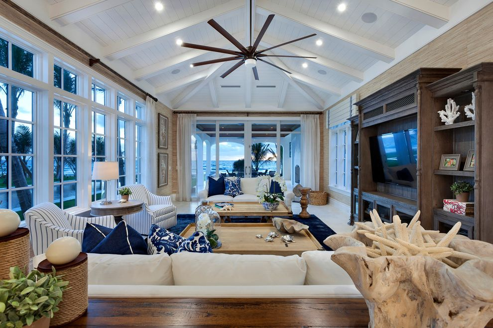 Gulf Coast Ceiling Fans   Beach Style Family Room  and Beach Front Blue Accent Color Blue Area Rug Built in Tv Wall Ceiling Fan Cream Sofa Floor to Ceiling Windows Ocean View Sea View Sheer Curtains Striped Arm Chairs Sun Room Water Front