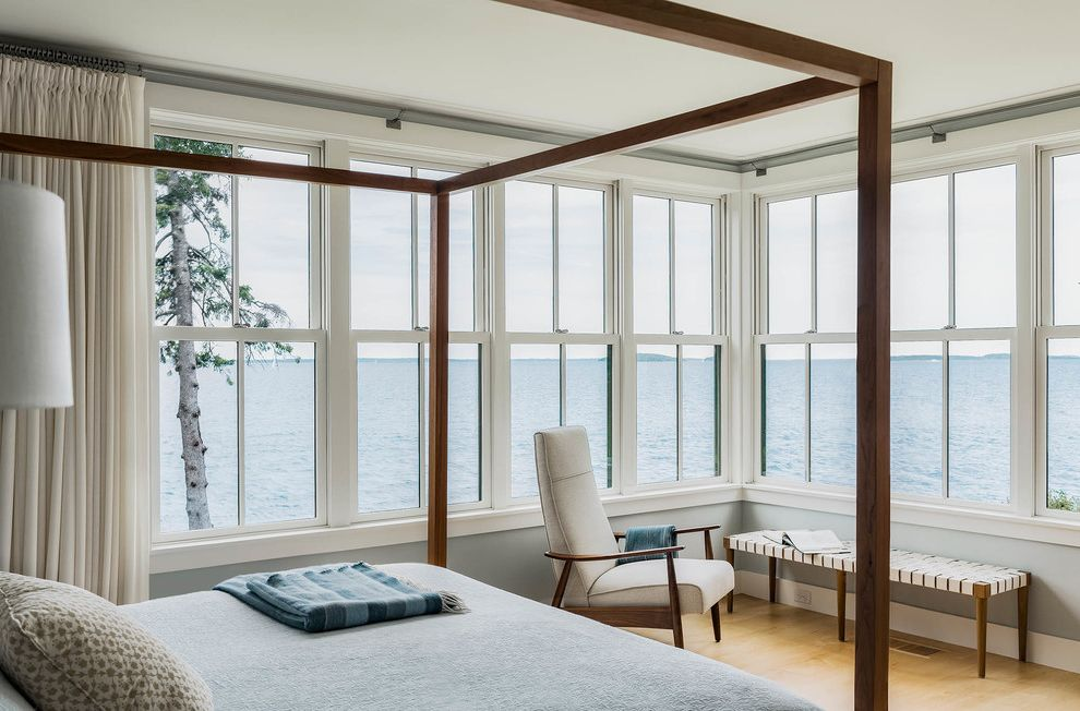Gulf Coast Windows with Beach Style Bedroom Also Armchair Bedding Bench Calm Canopy Bed Coastal Home Cool Colors Light Blue Lots of Natural Light Lots of Windows New England Pale Blue Peaceful Pillows Row of Windows Tranquil Water View White Curtains