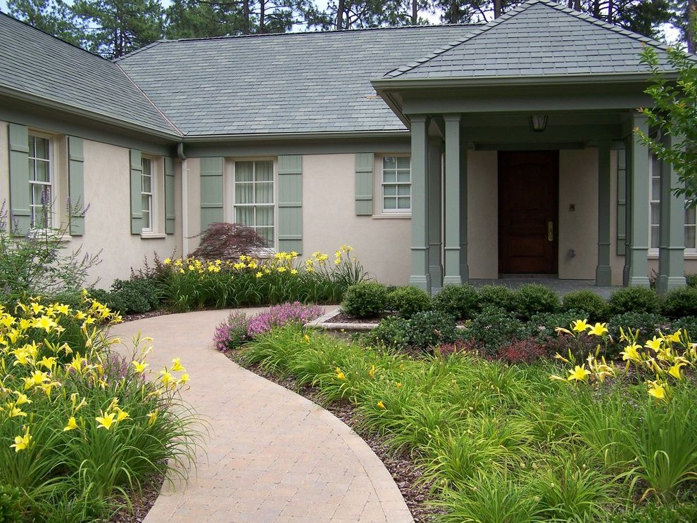 Gutter Shutter Reviews with Traditional Exterior Also Bark Mulch Covered Entry Curved Path Gable Roof Green Painted Trim Pavers Shutters Stucco Tall Grasses Winding Path