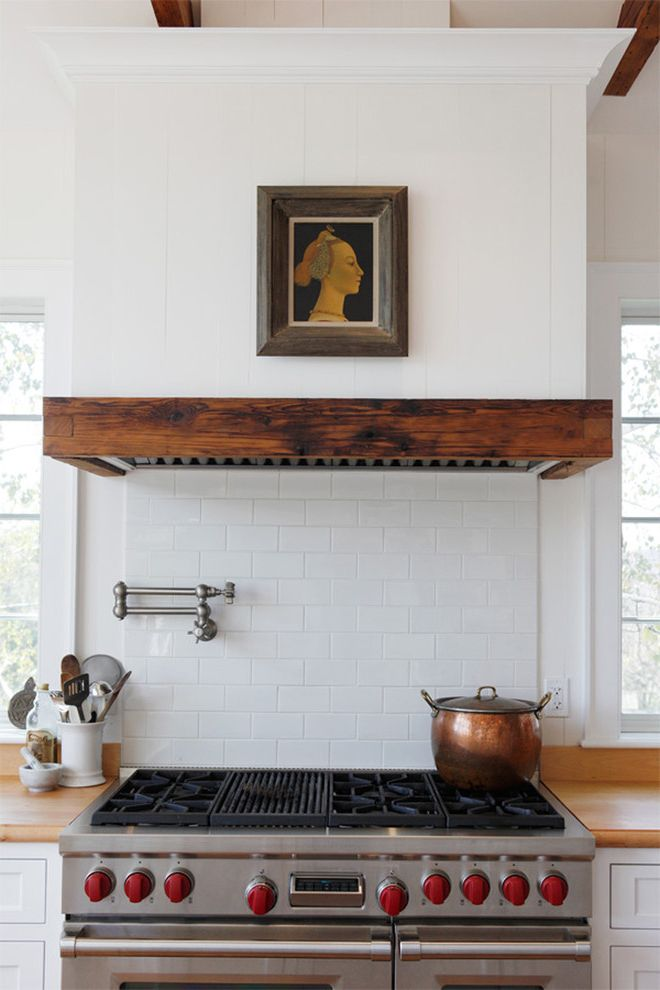 Guy C Lee Building Materials   Farmhouse Kitchen  and Artwork Copper Pot Painting Pot Filler Range Hood Tile Kitchen Backsplash Utensil Storage White Kitchen White Subway Tiles