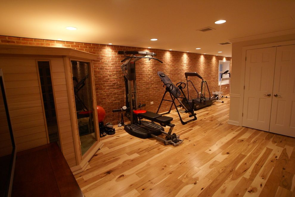 Gyms with a Sauna   Traditional Home Gym Also Brick Accent Wall Hardwood Hickory Home Gym in Basement Recessed Lighting Sauna