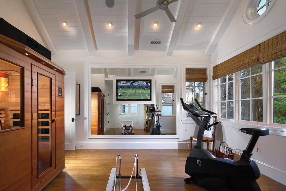 Gyms with a Sauna with Traditional Home Gym Also Ceiling Fans Exposed Beams Exposed Ceiling Beams Hardwood Flooring Home Gym Equipment Large Wall Mounted Tv Overhead Lighting Paneled Ceiling Saunas Wall Mounted Tv Ideas Wall Mounted Tv Windows