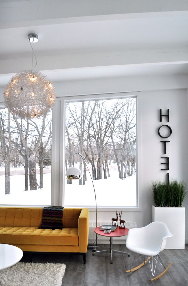 Habitat for Humanity Seattle with Midcentury Living Room  and Arc Lamp Colorful Accents Grey Floor Mid Century Modern Modern Icons Modern Light Fixture Plastic Rocking Chair Seasonal Snow Velvet Sofa Wall Letters Winter