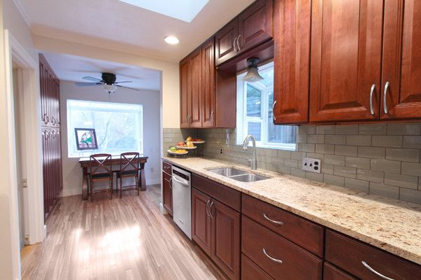Hanging a Ceiling Fan with Traditional Kitchen  and Backsplash Cherry Cabinets Cherry Kitchen Cherry Kitchen Cabinets Granite Marble Stainless Steel Tile
