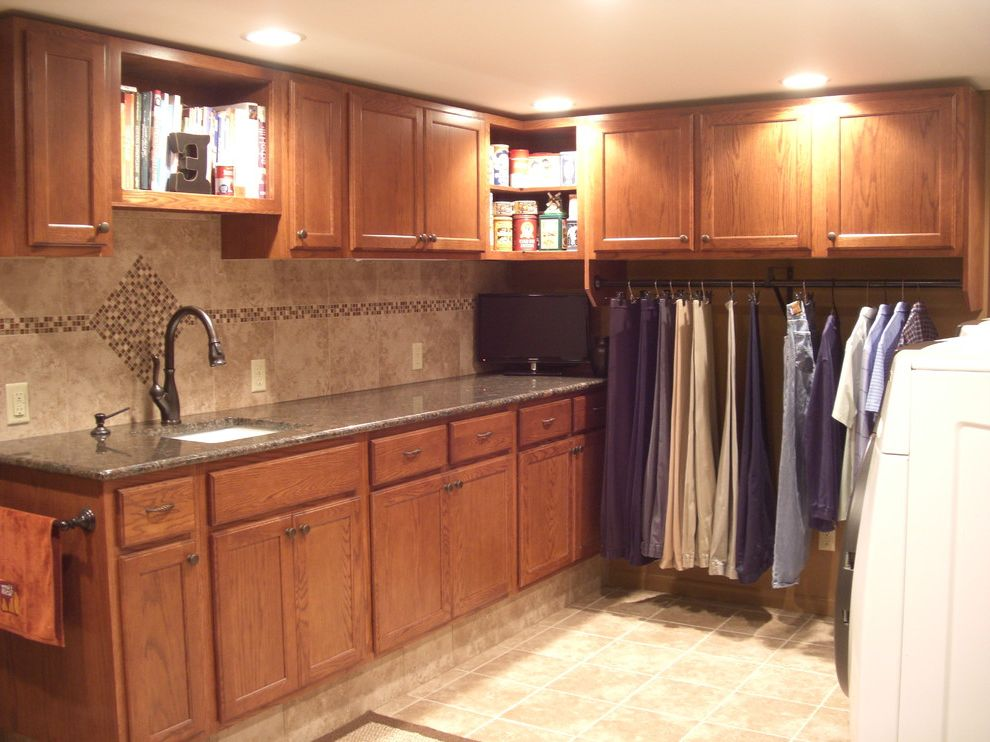 Hanging Bar for Clothes   Traditional Laundry Room  and Glass Tile Backsplash Hanging Space Oak Mission Cabinetry Oil Rubbed Bronze Delta Faucet Open Shelves Raised Cabinetry for Functional Folding Tan Brown Granite Tile Floor