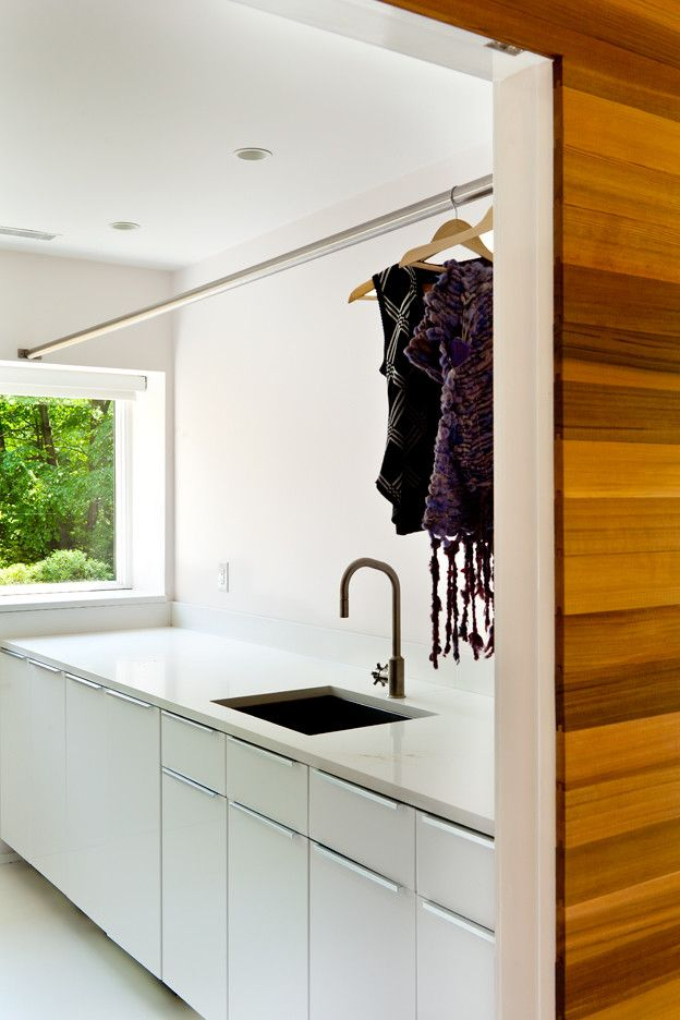 Hanging Bar for Clothes with Midcentury Laundry Room  and Cedar Siding Cedar Walls Corten Steel Epoxy Floors Exposed Trusses Large Windows Mid Century Modern Modern Renovation Wood Paneling Woods