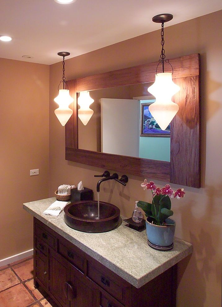 Hanging Heavy Mirror on Drywall   Tropical Bathroom  and Bathroom Mirror Ceiling Lighting Container Plants Framed Mirror Granite Countertops Orchid Pendant Lighting Potted Plants Recessed Lighting Tan Wall Tile Flooring Vanity Sink Cabinets Vessel Sink