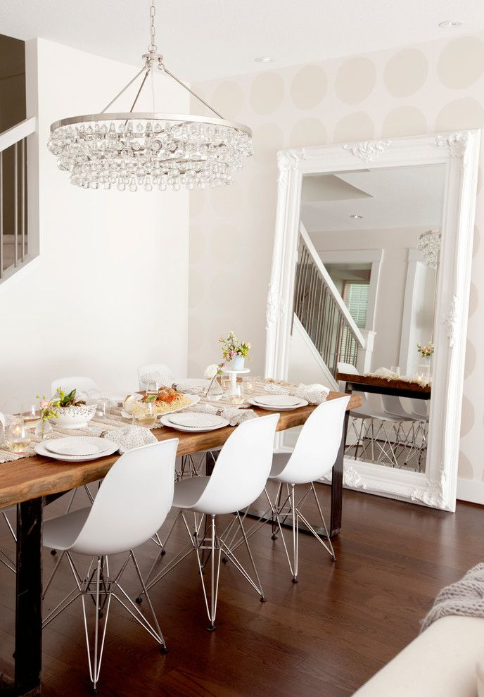 Hanging Heavy Mirror on Drywall with Contemporary Dining Room Also Chandelier Eames Chairs Leaning Mirror Oversize Mirror Polka Dot Wallpaper Wallpaper
