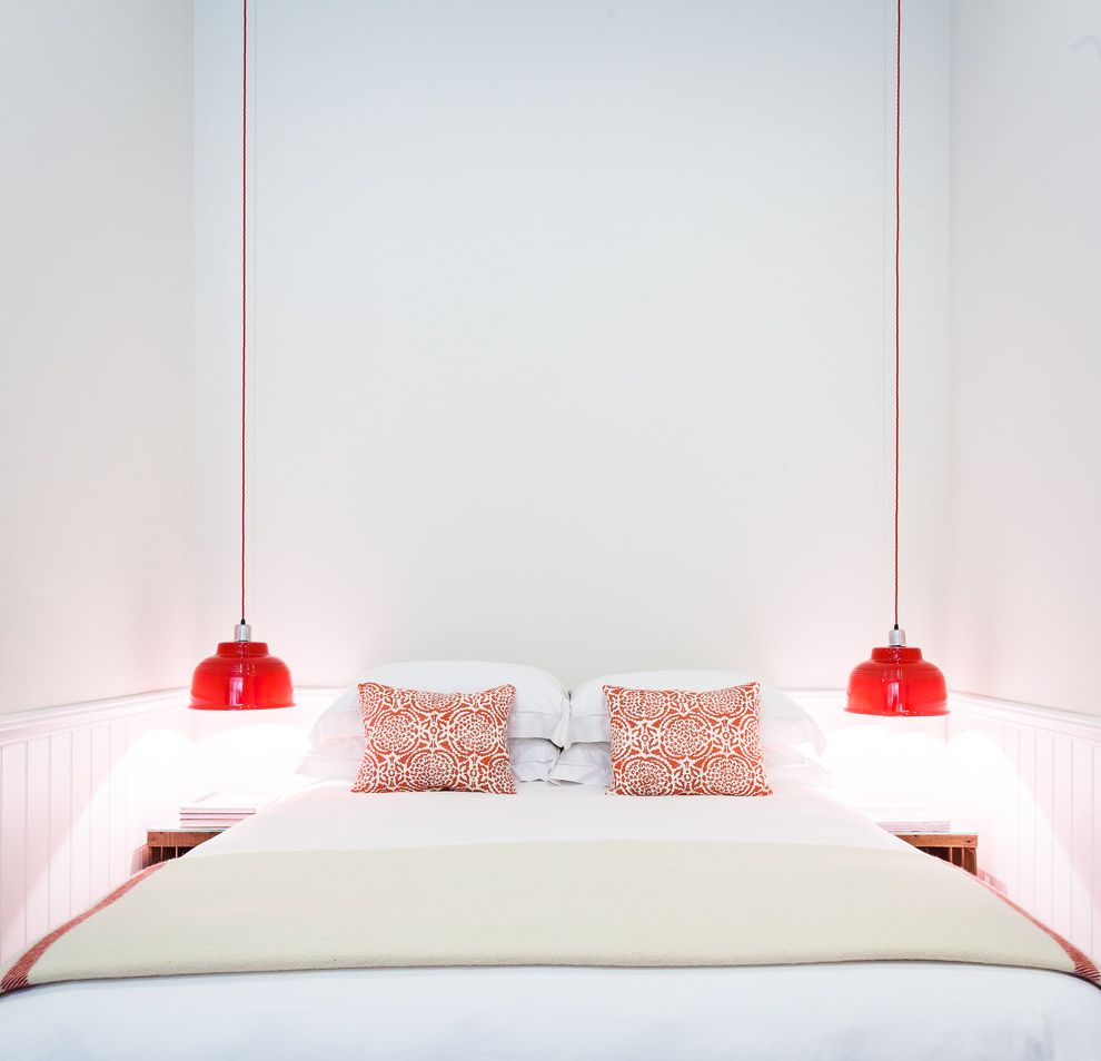 Hanging Lamps with Chain   Beach Style Bedroom Also Coastal Red and White Throw Pillows Red Pendant Lights Symmetry White Beadboard Wainscoting White Bedding Wooden Nightstands