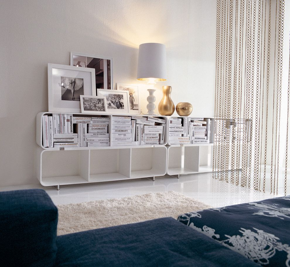 Hanging Lamps with Chain with Contemporary Living Room  and Beads Blue Sofa Bookshelves Chains Curved Modern Shelves Photograph Screen Shag Rug Vase White