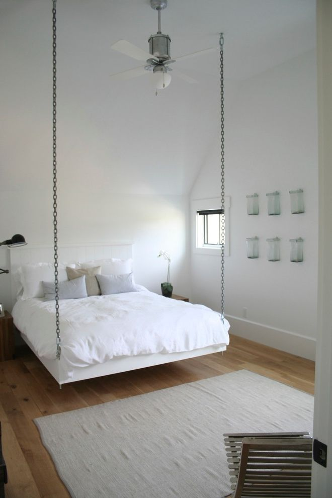 Hanging Lamps with Chain with Farmhouse Bedroom Also Area Rug Ceiling Fan Chains Hanging Bed Nightstands Pillows Small Window Vaulted Ceiling Wall Art Wood Floor Wood Slat Chair
