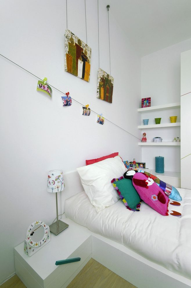 Hanging Photos on Wire   Modern Kids  and Bed Pillows Bedroom Bedside Table Built in Shelves Colorful Accents Floating Shelves Nightstand Photo Cable Wall Art Wall Decor White Bedding