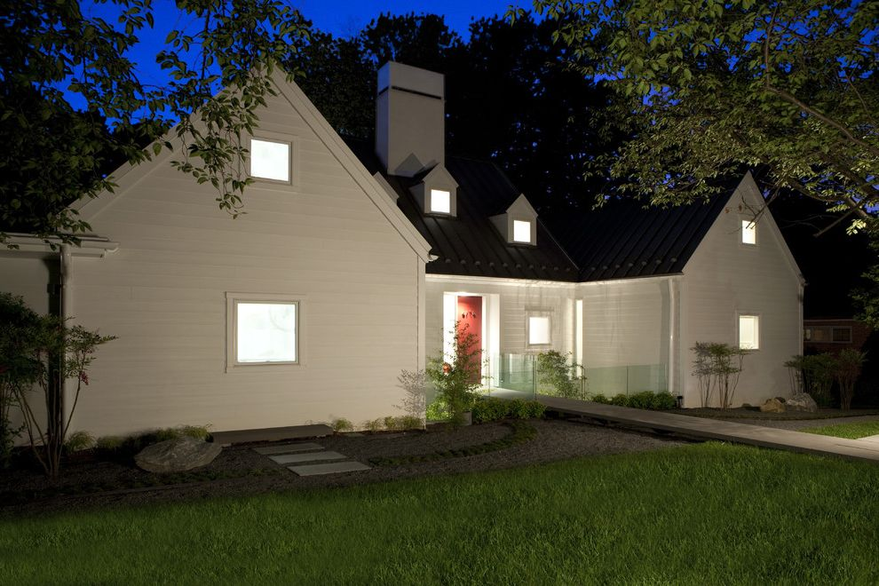 Hardie Board Planks with Transitional Exterior Also Dormer Windows Glass Railing Grass Lawn Metal Roof Outdoor Lighting Path Ramp Red Front Door Roof Line Standing Seam Roof Turf Walkway White House White Wood Wood Siding
