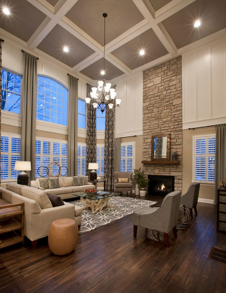 Hardwood Store of Nc with Traditional Living Room  and Beige Sectional Sofa Chandelier Coffered Ceiling Glass Top Coffee Table Gray and White Area Rug Gray Armchair High Ceiling Stone Wall
