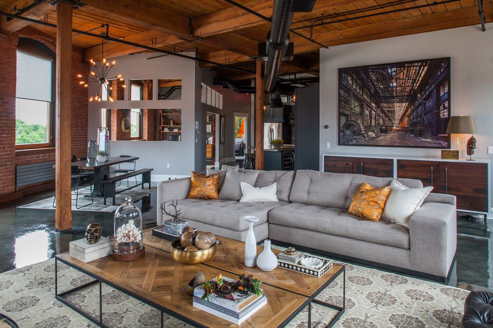 Hdbuttercup with Industrial Living Room Also Arched Windows Brick Wall Framed Artwork Gray Sofa High Ceiling Orange Pillows Sputnik Chandelier Two Coffee Tables Wood Ceiling