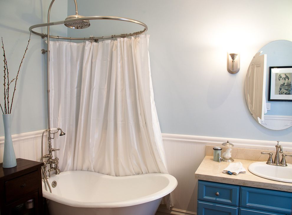 Head Start Fargo with Eclectic Bathroom  and Bath Blue Blue Paint Blue Vanity Clawfoot Tub Faucet Oval Mirror Rain Shower Shower Curtain Shower Head Soaker Bath Soaker Tub Tub Vanity