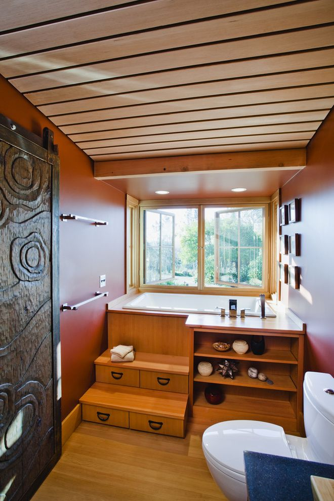 Healdsburg Spa   Farmhouse Bathroom  and Arkin Bathroom Bookshelves Carved Wood Casement Windows Furo Ideagarden Soaking Tub Soffit Steps Steps to Tub Storage Tansu Tilt Tub Wood Floor Wood Slat Ceiling