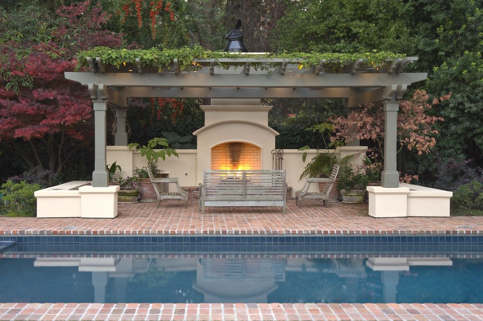 Healdsburg Spa with Traditional Pool  and Brick Paving Container Plants Garden Bench Lounge Area Outdoor Fireplace Patio Patio Furniture Pergola Pool Deck Potted Plants Privacy Screen Trellis