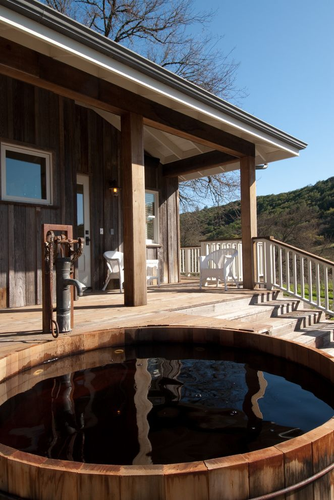 Healthmate Hot Tubs with Farmhouse Porch and Barrel Tub Deck Guest House Reclaimed Barn Siding Rustic Wood Tub