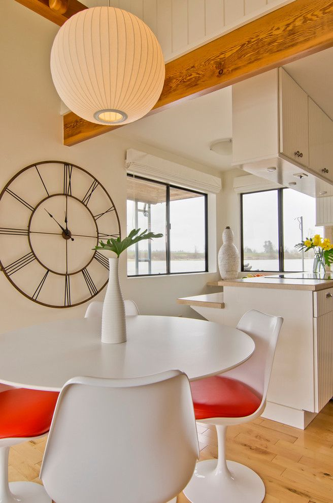 Herman Miller Clocks   Contemporary Dining Room Also Exposed Beams Globe Lantern Kitchen Clock Kitchen Table Modern Icons Pedestal Table Round Dining Table Tulip Table Wall Clock White Dining Furniture Wood Flooring