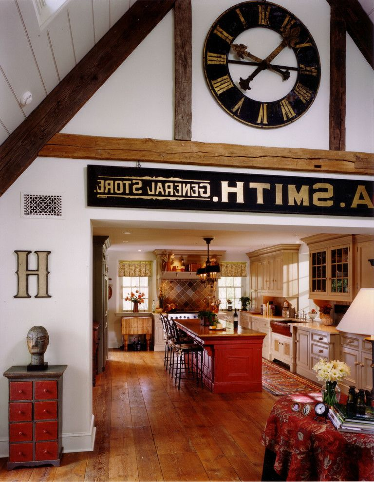Herman Miller Clocks   Eclectic Kitchen Also Bar Seating Big Clock Cathedral Ceiling Kitchen Island Medium Wood Flooring Red Red Island Roman Numeral Wall Clock Rustic Wood Floor Skylights Wall Sign White Walls Wood Beams