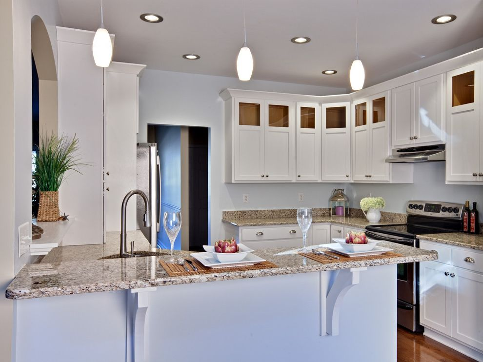 Hidden Countertop Support Brackets with Contemporary Kitchen Also Breakfast Bar Ceiling Lighting Eat in Kitchen Granite Countertops Kitchen Hardware Pendant Lighting Peninsula Recessed Lighting Shaker Cabinets White Cabinets Wood Cabinets